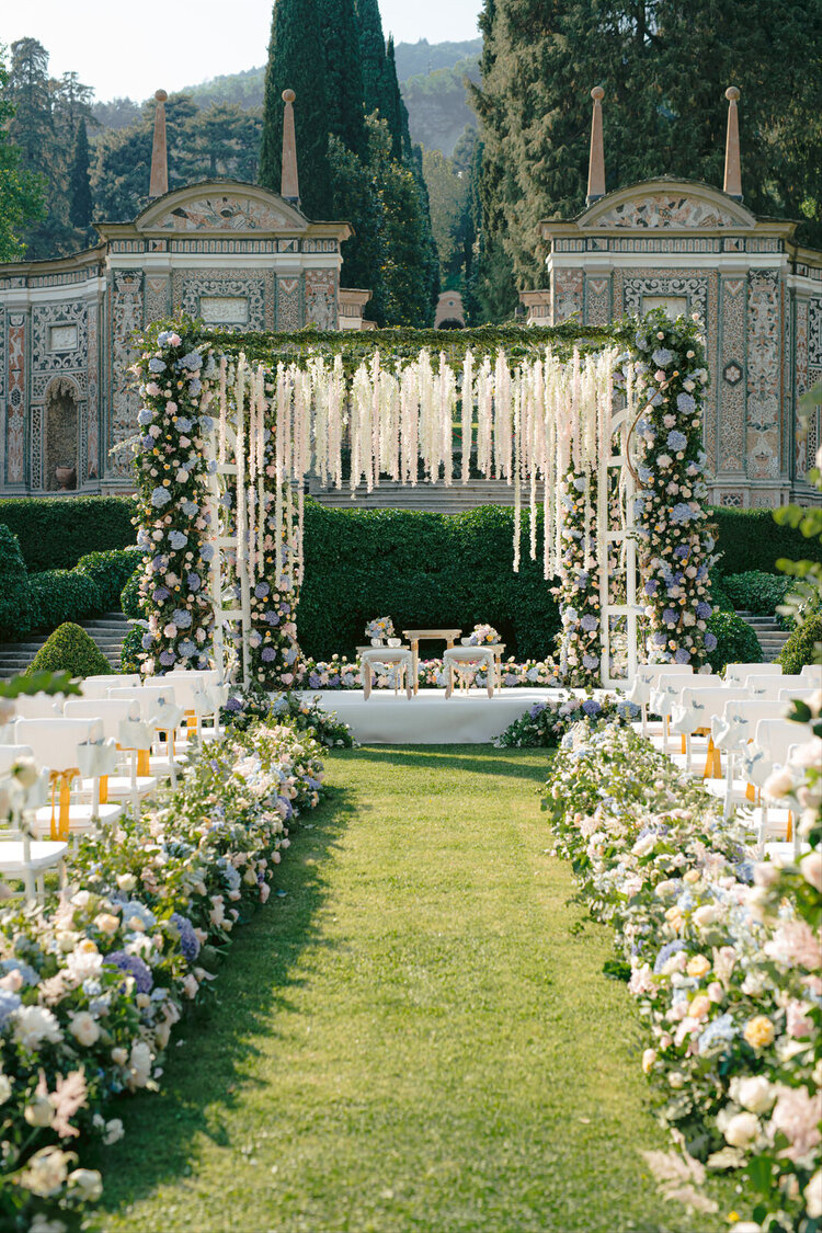 Outside ceremony gazebo with hanging flowers