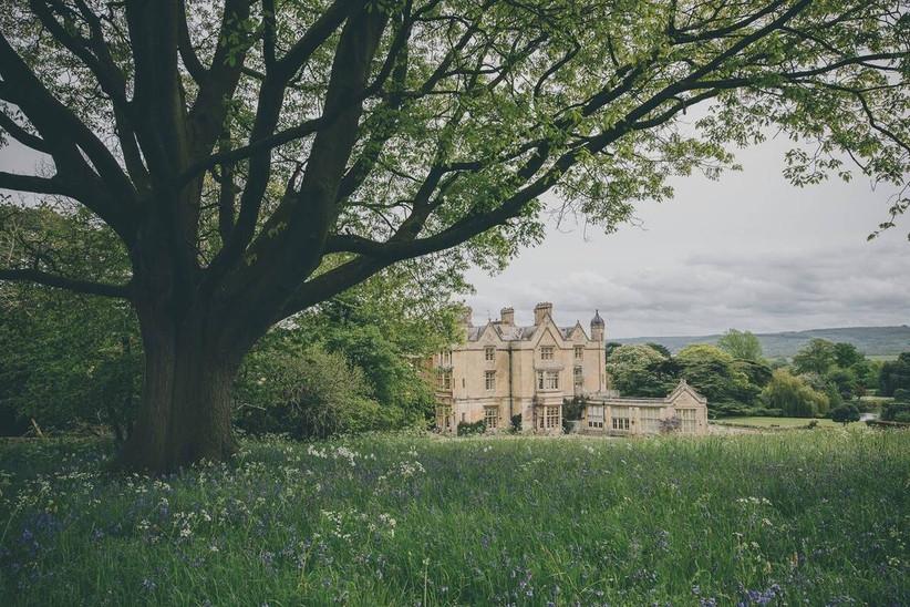 Manor hall hotel wedding venue next to a meadow