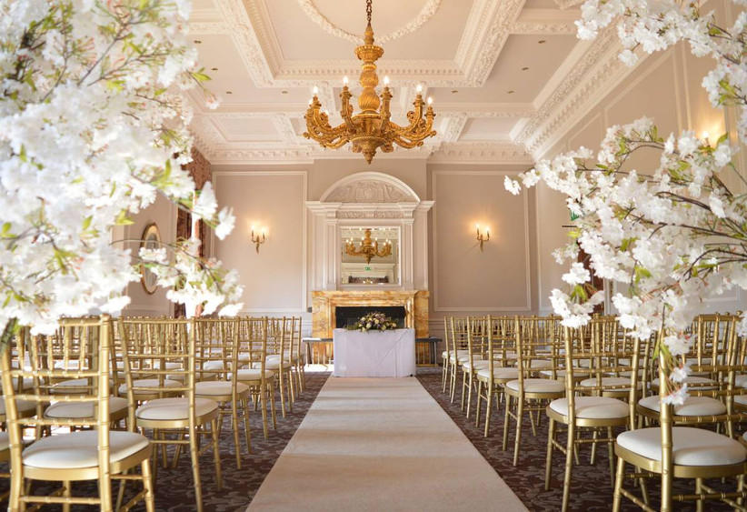 Wedding ceremony wall with white florals