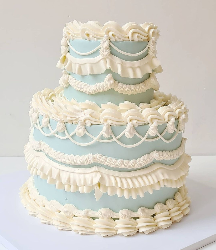 Baby blue tiered wedding cake with white ruffles