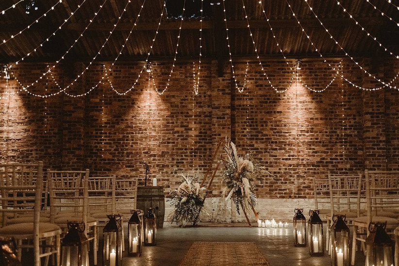 Stone walled ceremony wedding room with fairy lights