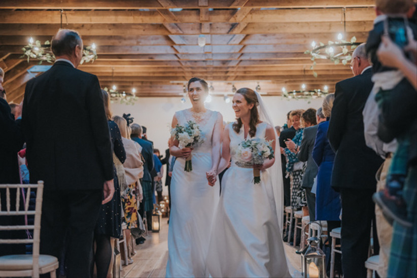 Bride and bride walk up the aisle