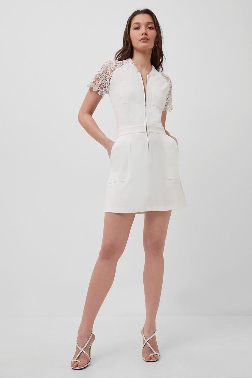 Model wearing a short white wedding dress