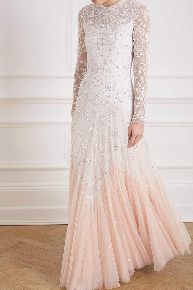 Model wearing a pink and white sequin long sleeved wedding dress