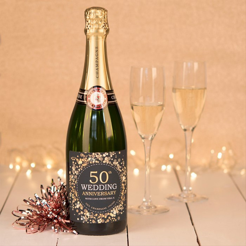50th anniversary champagne bottle with flutes