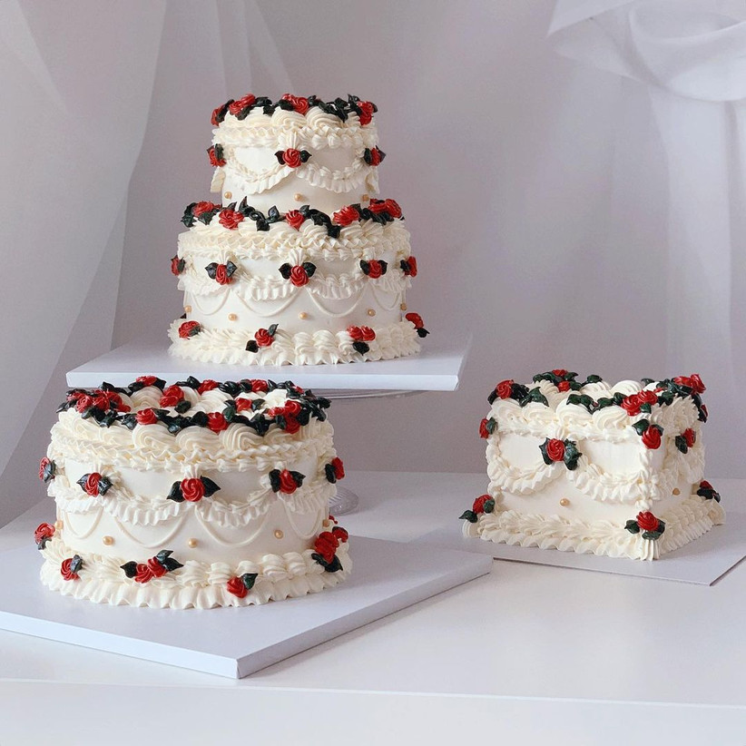 Three white cakes with red rosebuds