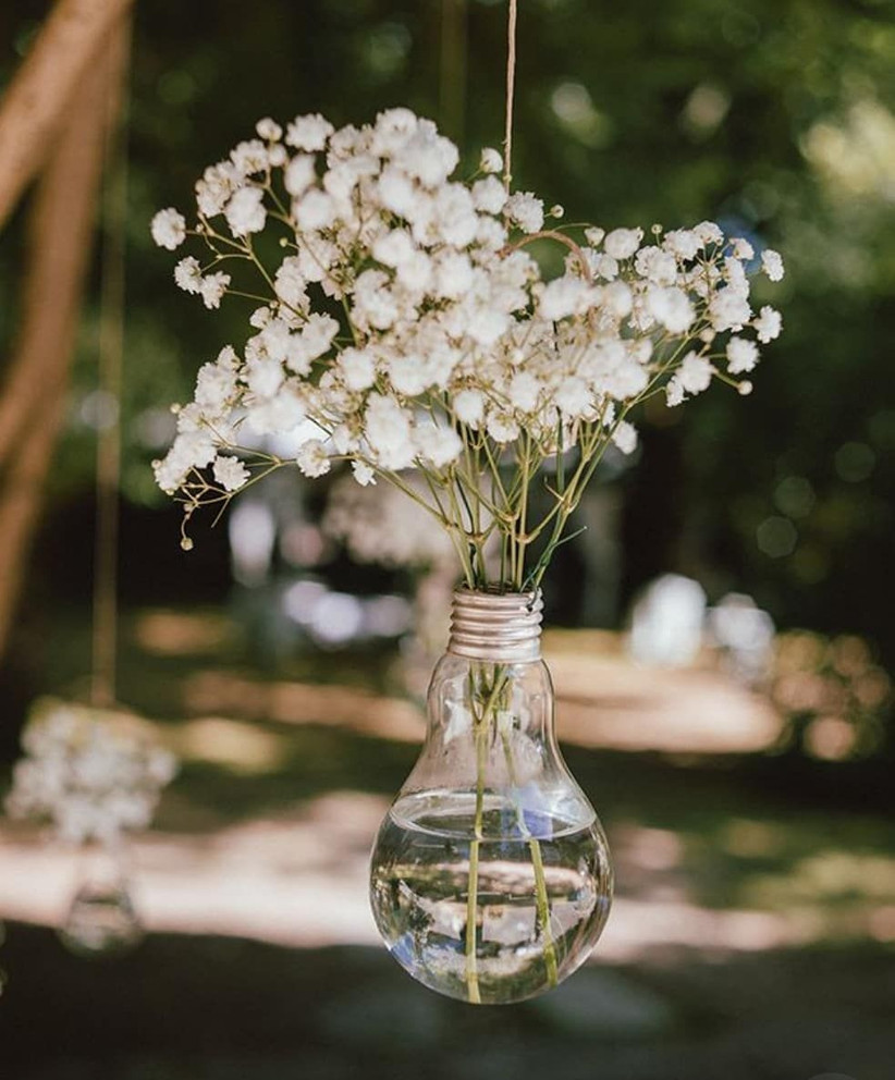 Hanging bulb vase with white flowers