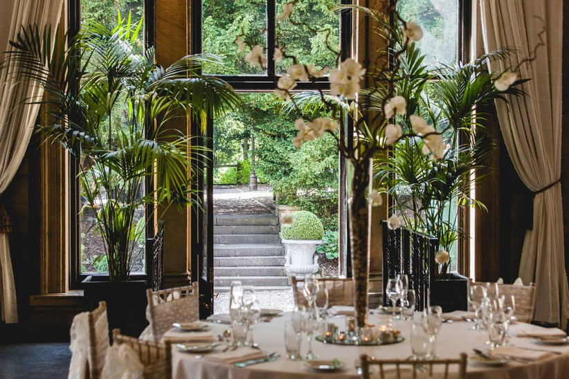 Wedding dining area with glass doors out into a garden