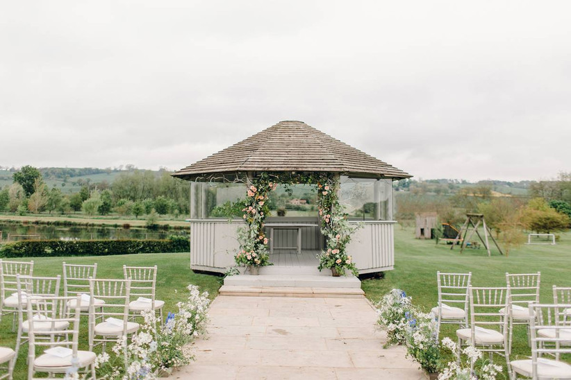 Outside wedding ceremony overlooking the countryside