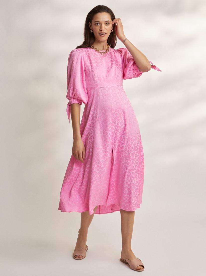 Model wearing a pink midi dress