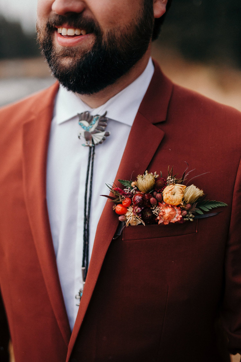 Groom wearing an autumn wedding buttonhole