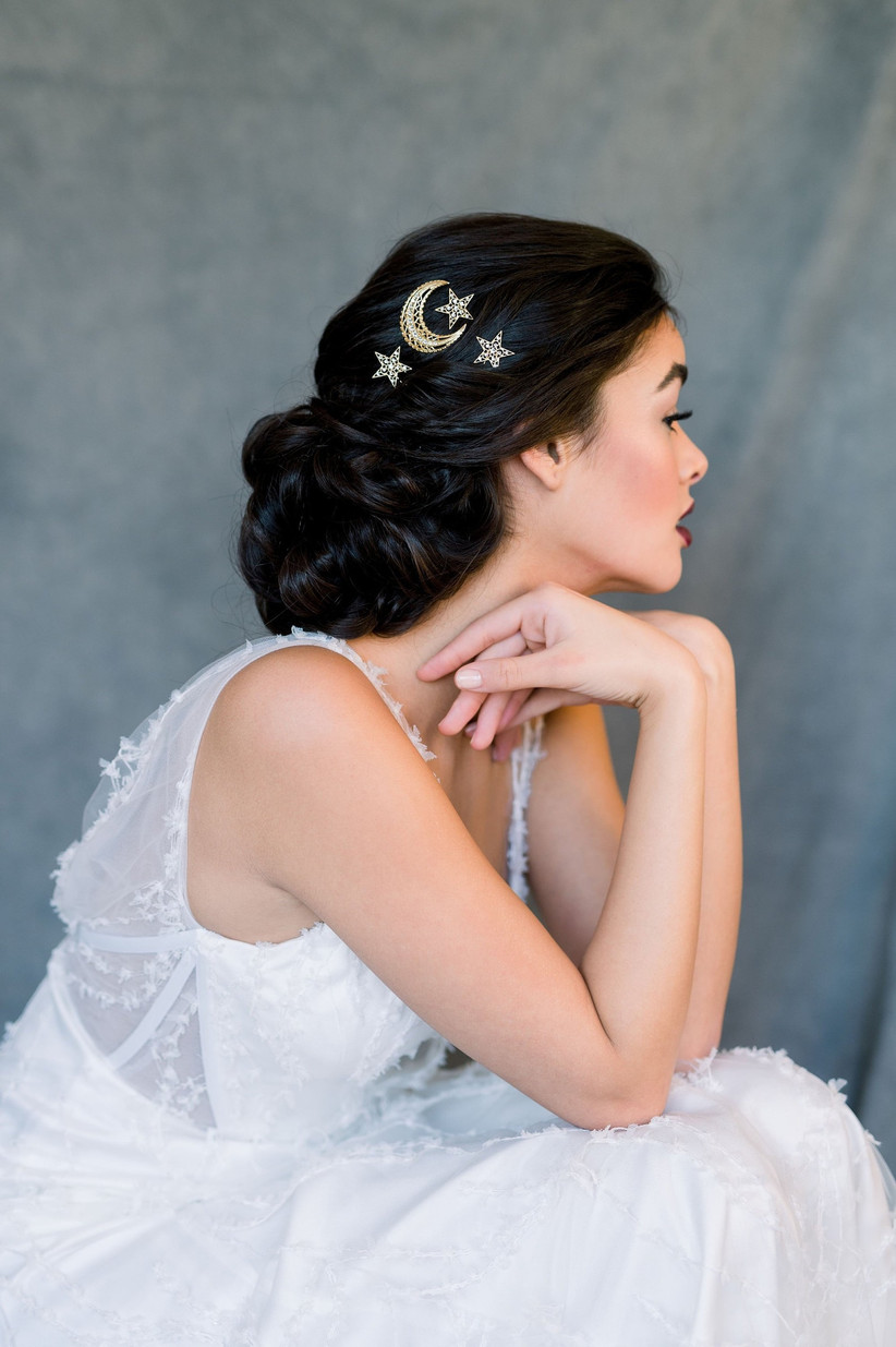 Model with a sleek bun and star and moon clips