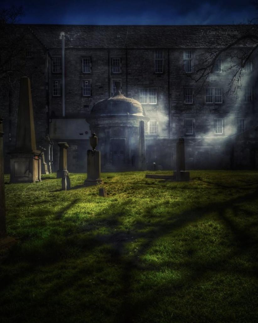 Misty graveyard at nightfall