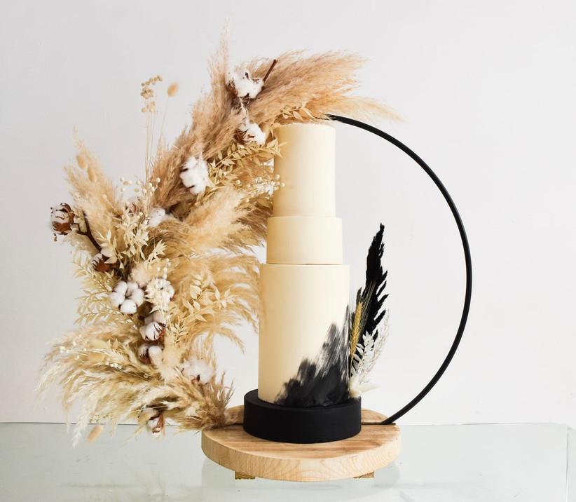 Black circular and wood wedding cake stand