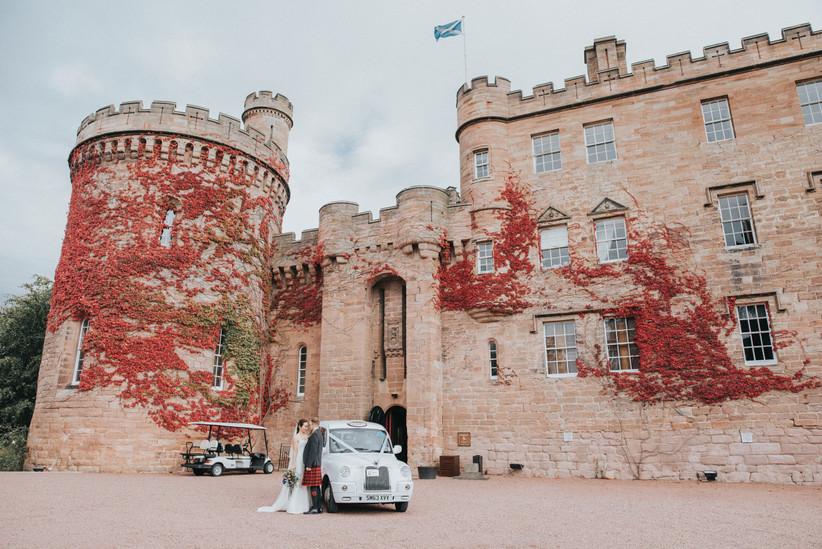 Castle wedding venue with a classic car