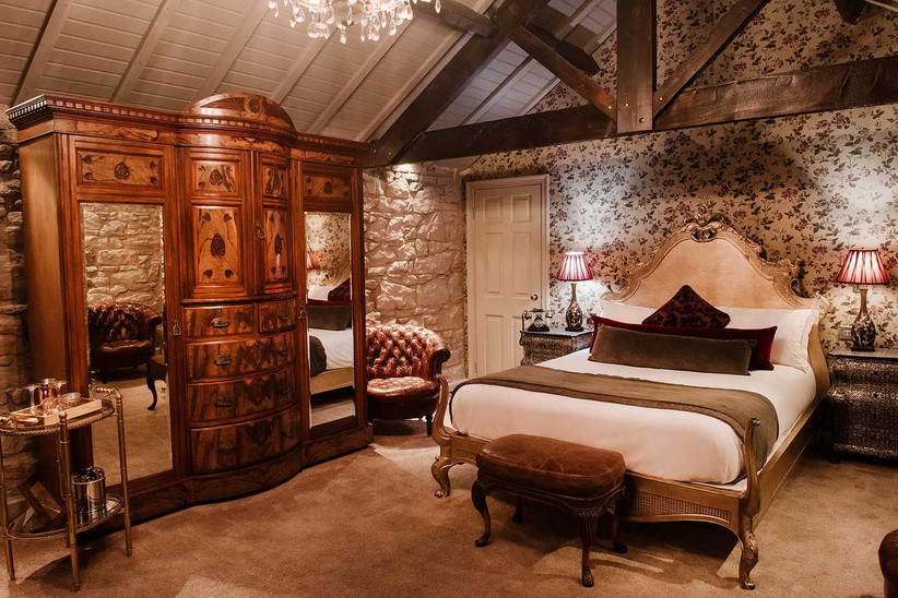 Bed and walnut wardrobe in the bridal suite at Newton Hall