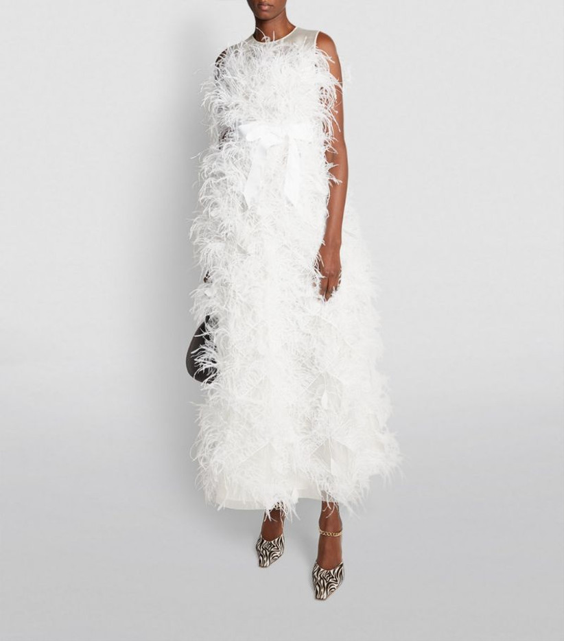 Model wearing a full feathered wedding dress