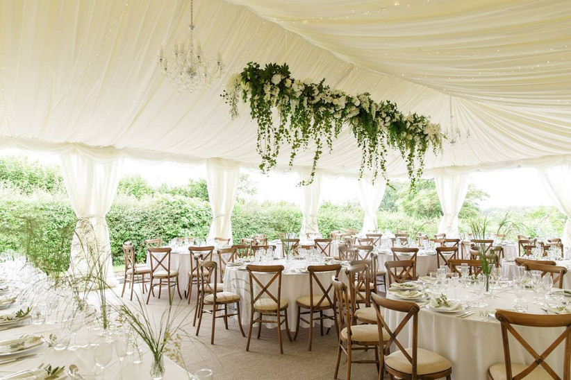 Wedding marquee decorated in greenery