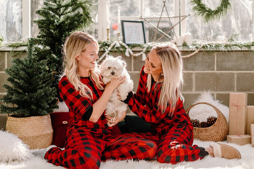 Couple with dog in matching tartan pyjamas