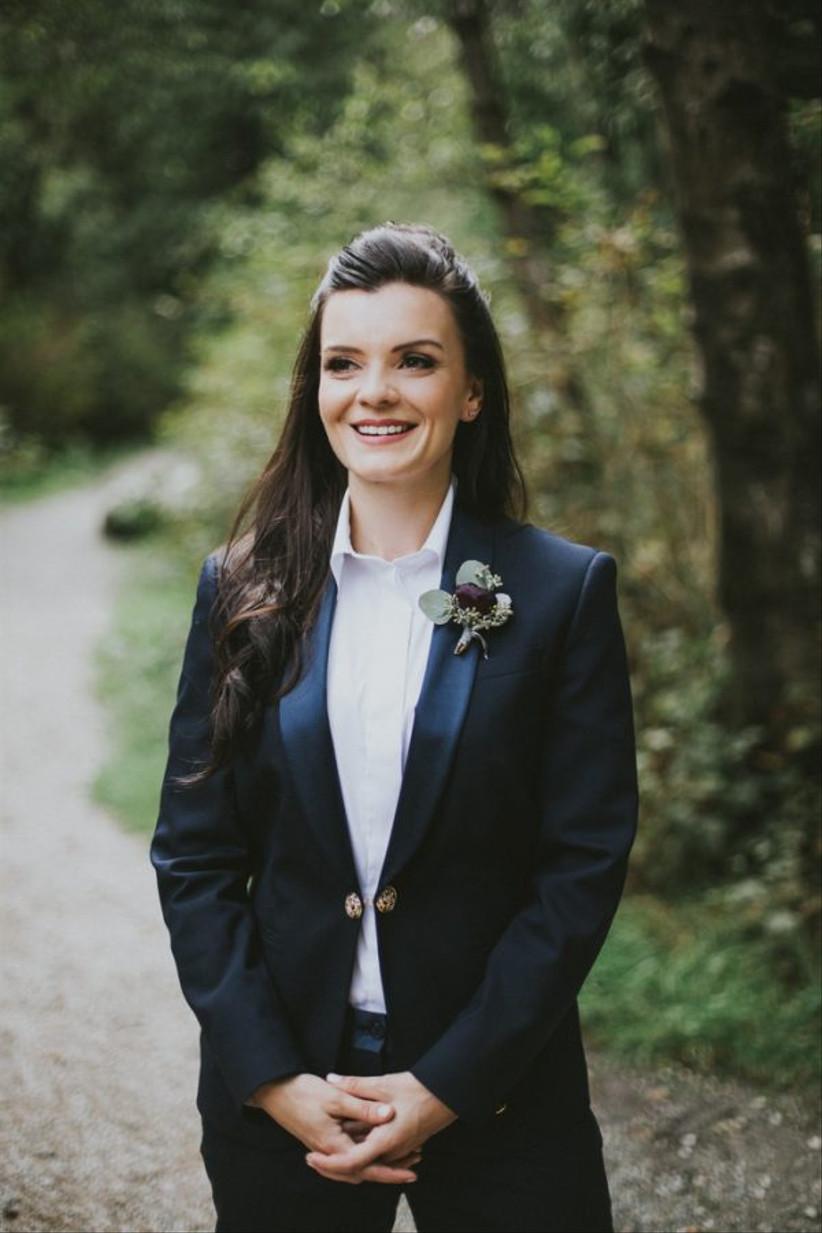 Bride wearing a floral wedding buttonhole