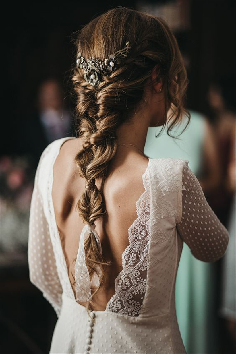 Model with an embellished bubble plait