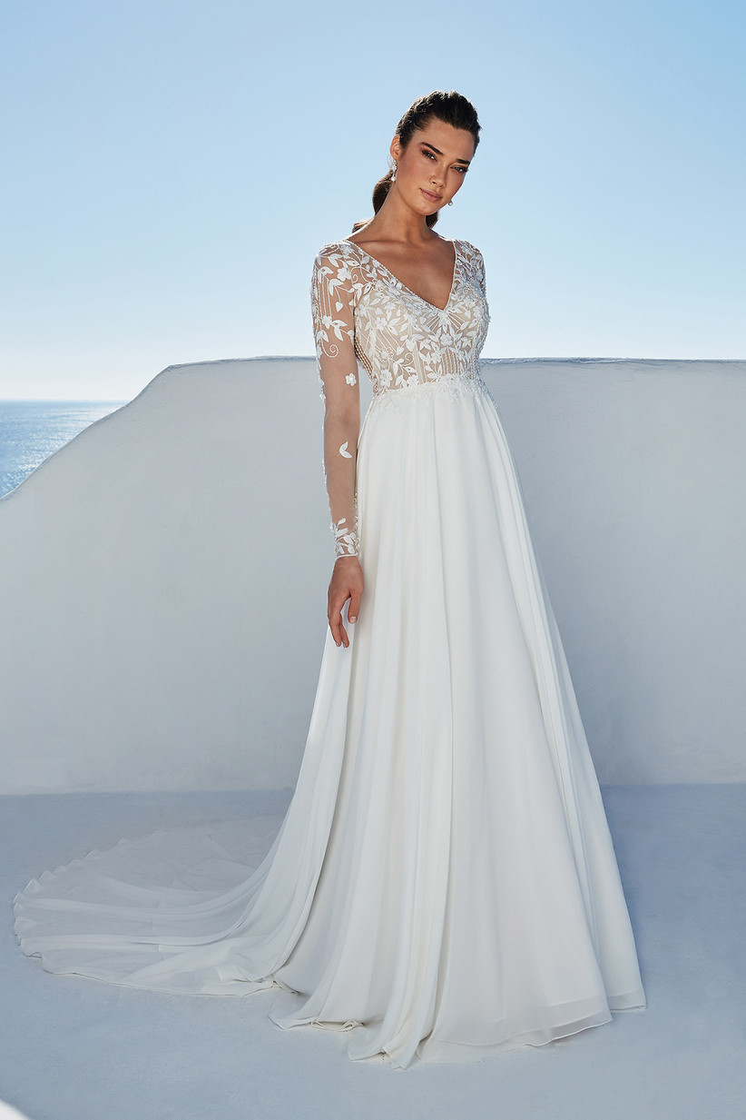 Model wearing a wedding dress with sheer long sleeves