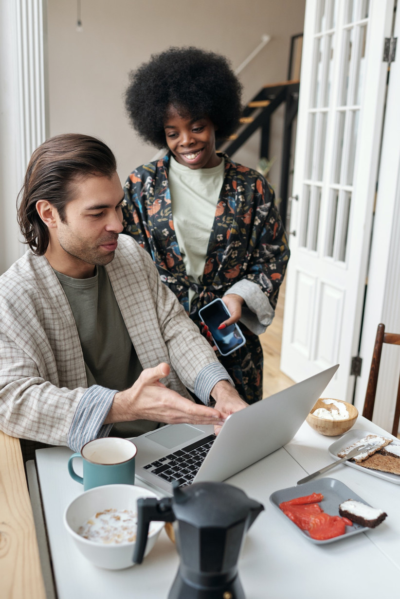 Couple in their dressing gowns online shopping