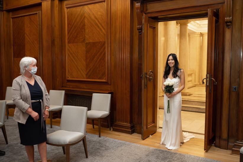 Bride at doorway of ceremony room