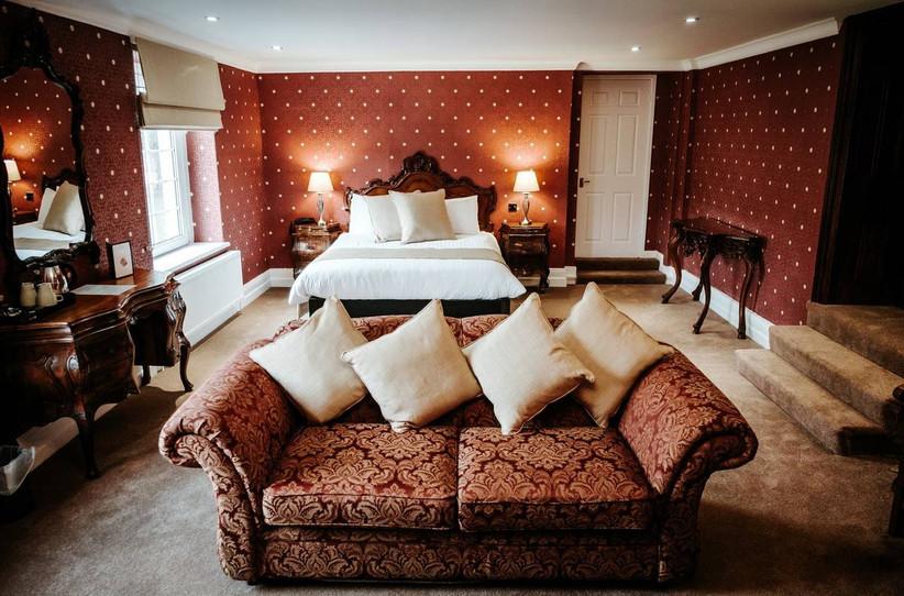 Red polka dot wallpaper bedroom