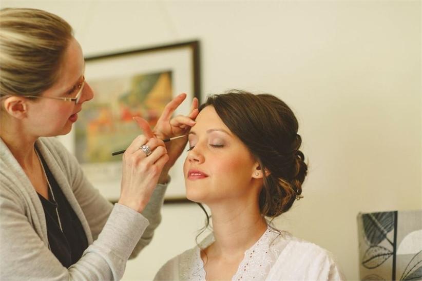 makeup-artist-applying-makeup-to-bride-2