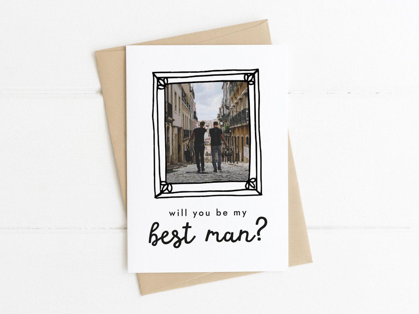 White card featuring a picture of two men on holiday with the title will you be my best man