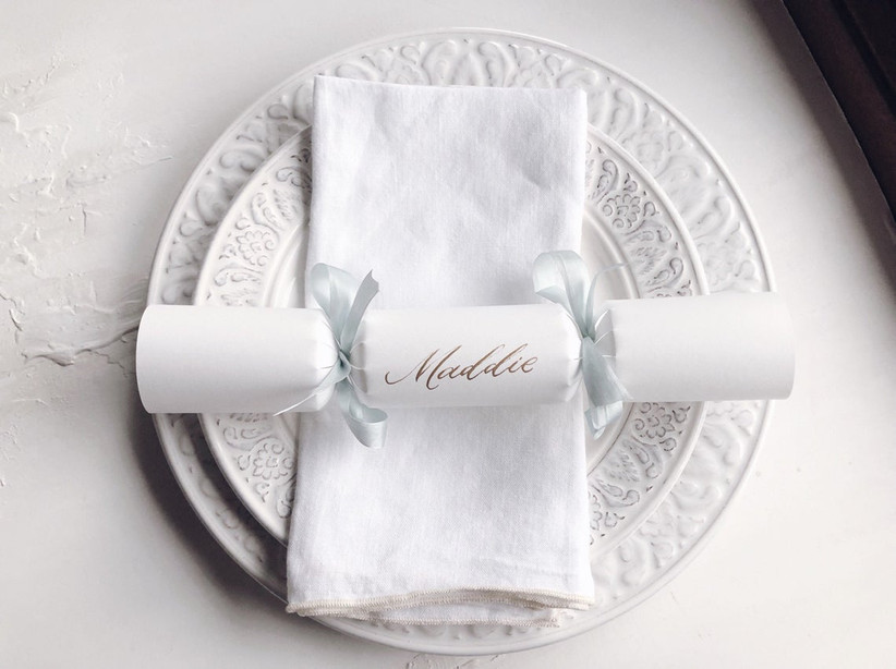 Personalised silver and white Christmas cracker on a plate