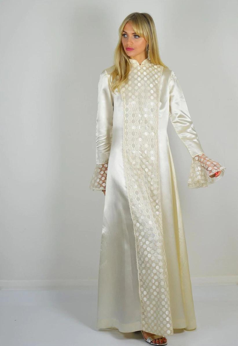 Woman wearing long-sleeve kaftan-style wedding dress
