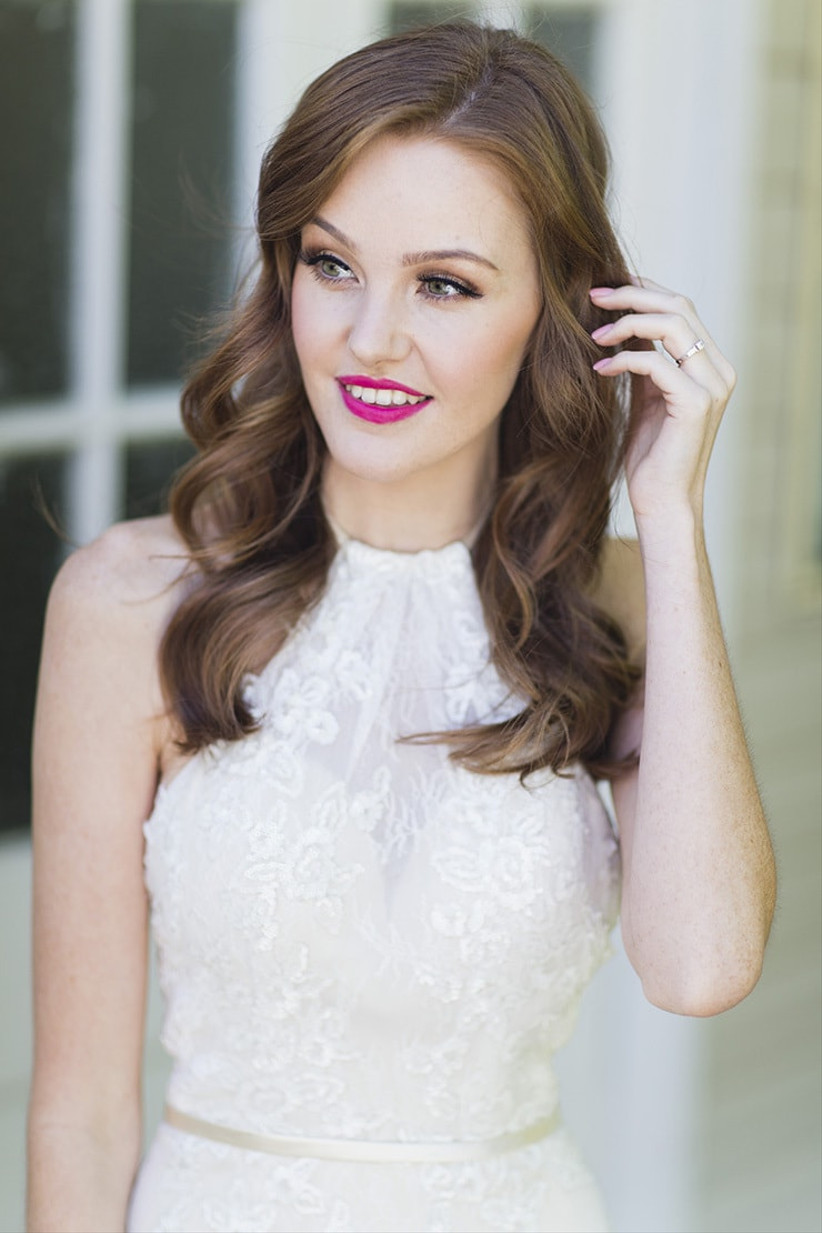 Bride with hot pink lipstick and waved hair