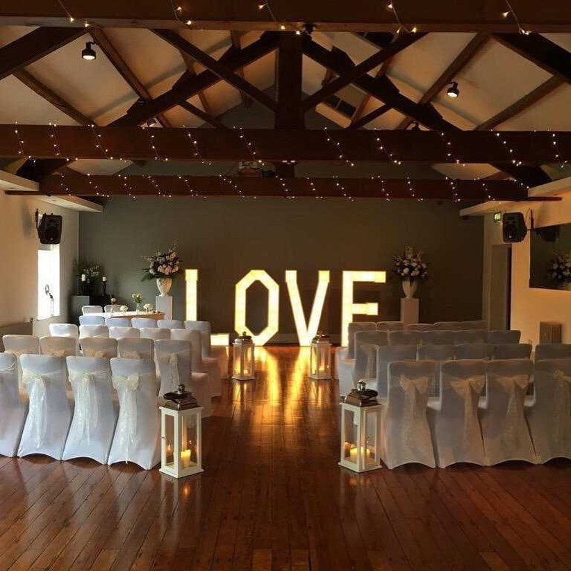 Manchester wedding venue The Castlefield Rooms with light-up love sign