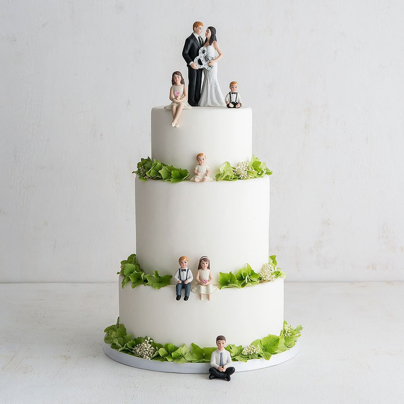 Three tiered wedding cake with family model wedding cake toppers