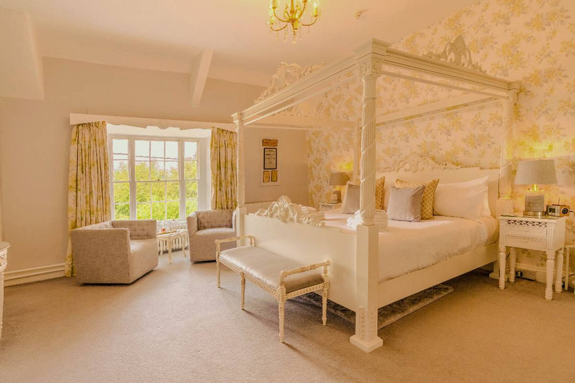 White bedroom with four poster bed
