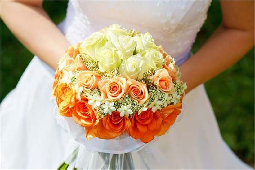 this-bouquet-with-orange-summer-wedding-flowers-is-complemented-with-peach-and-cream-roses-as-well-as-layers-of-gypsophila