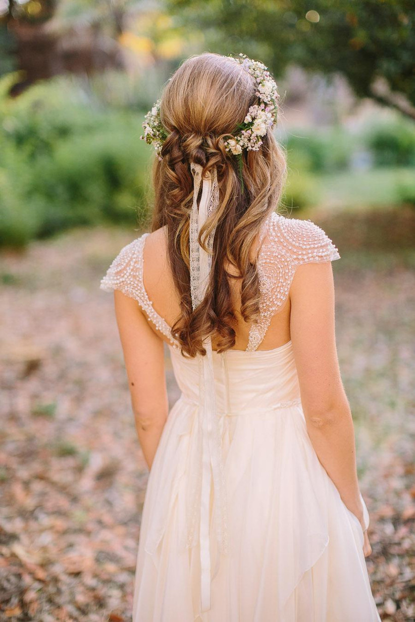 Half up half down hairstyle with floral head band and ribbon