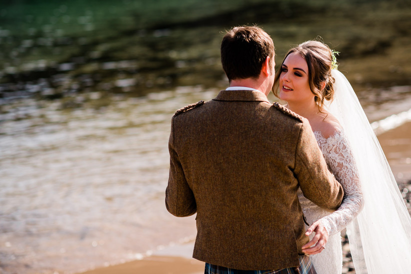 Caitlin and Stephen having their first dance on the beach