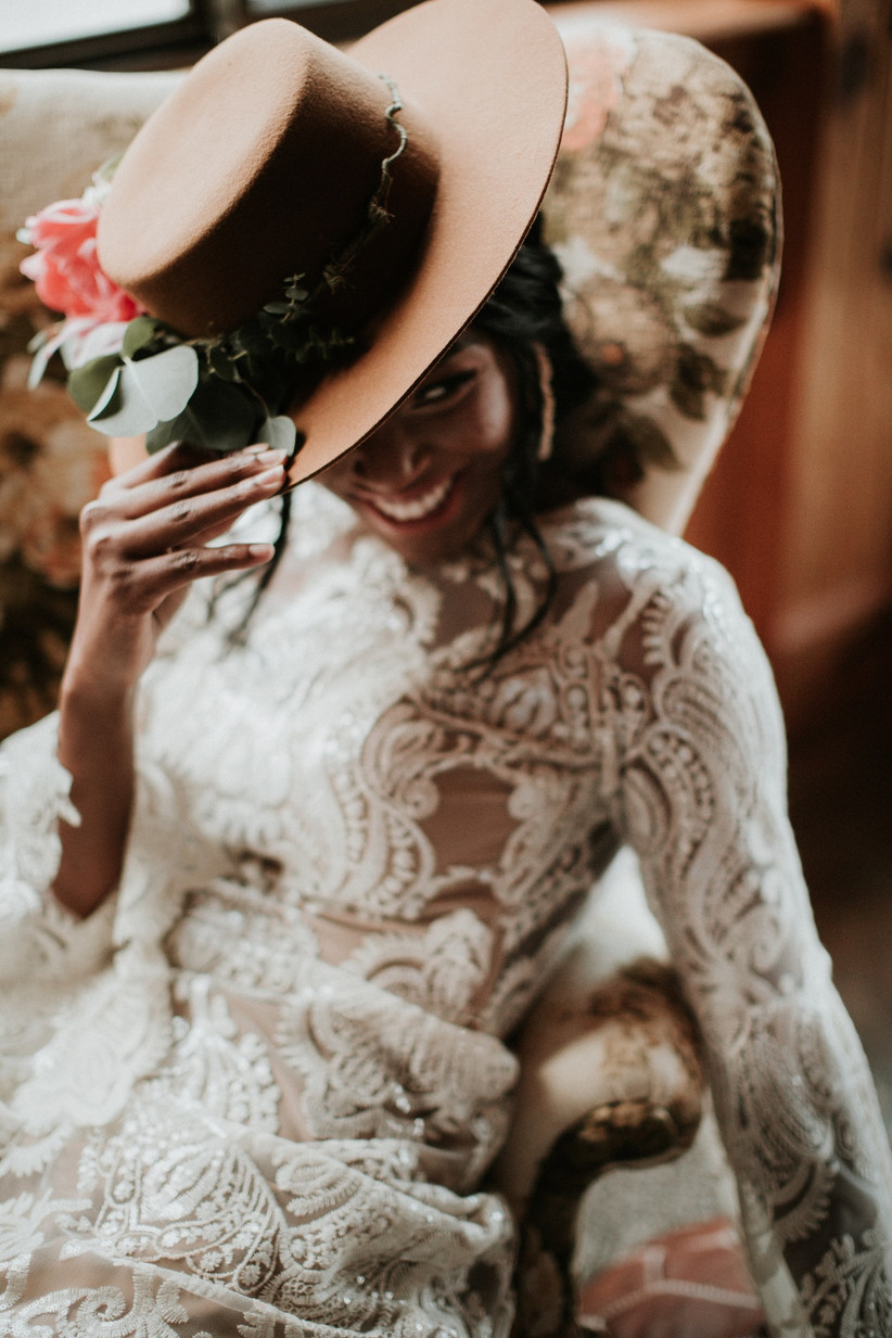 Bride in a wedding dress and a brown hat