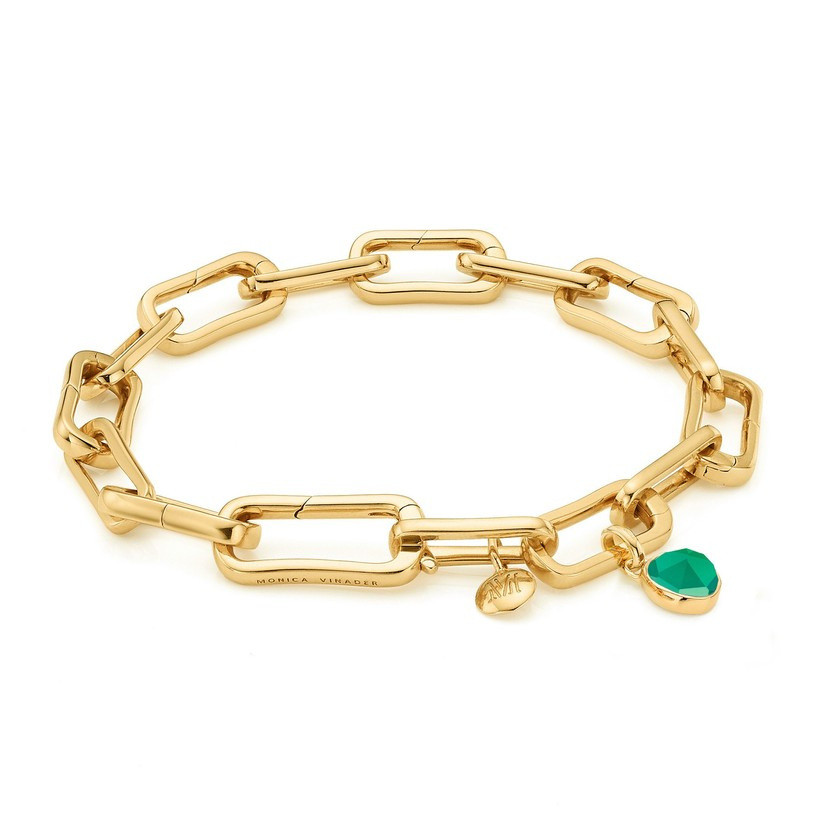 Gold chain bracelet with a green stone
