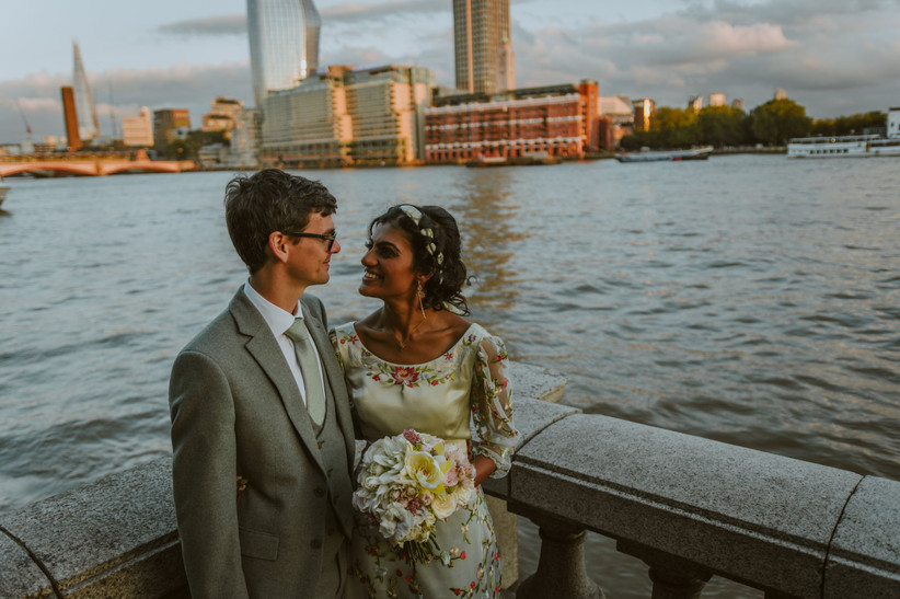 Nirosha and Dafydd in front of the Thames in London