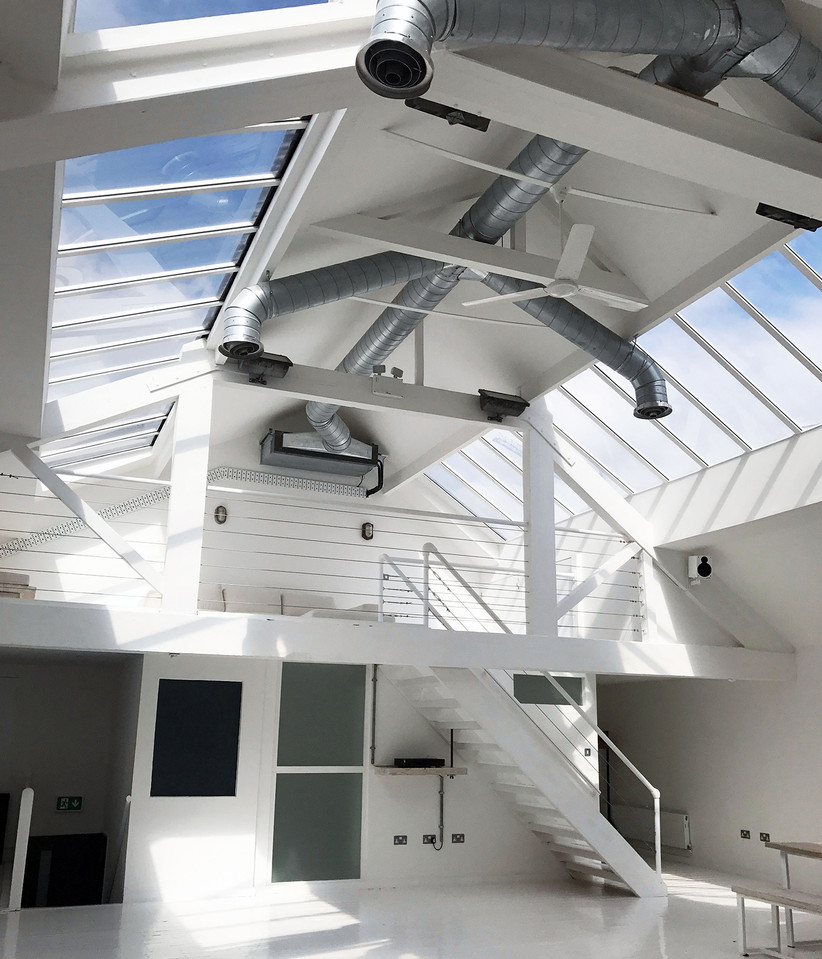 Interior of Manchester wedding venue fivefourstudios with plain white walls