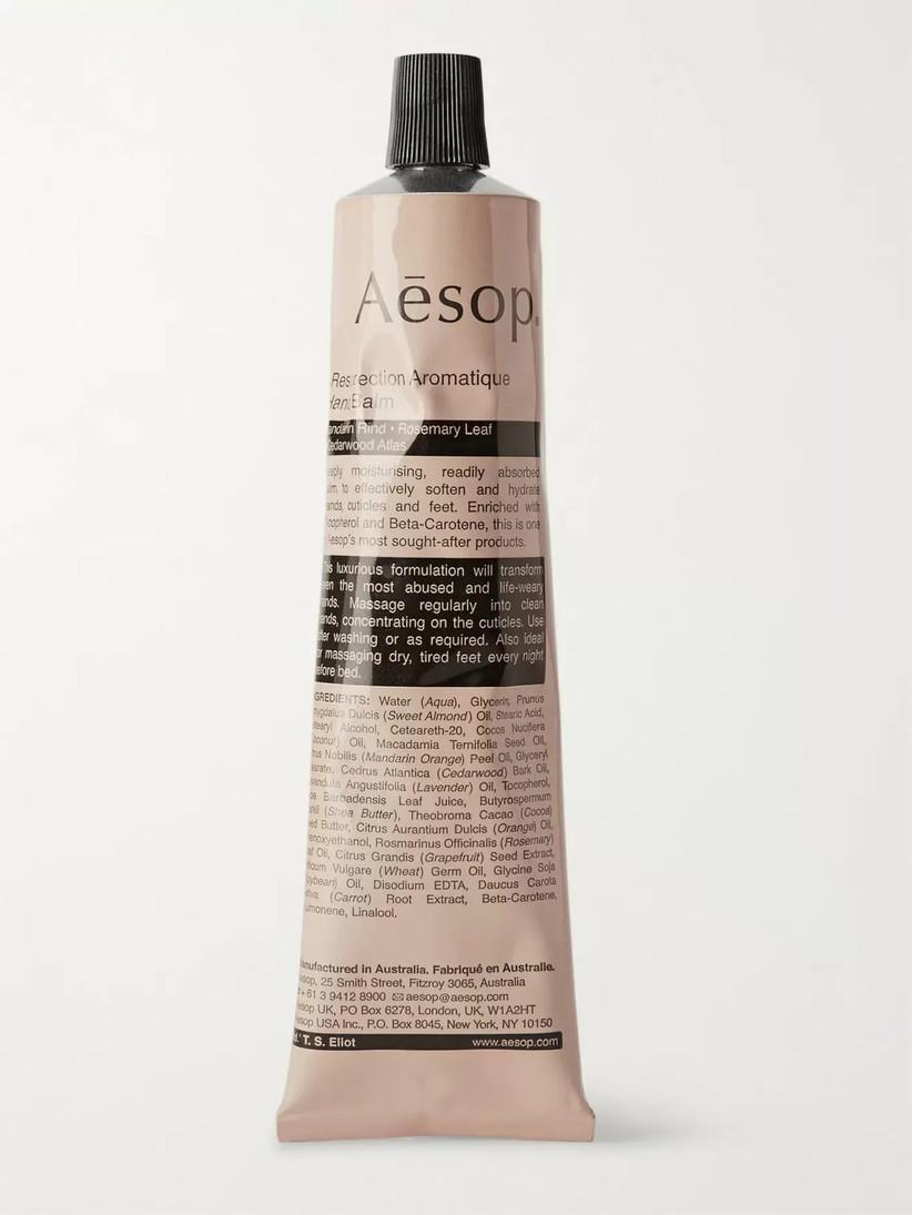 A cream tube of Aesop Hand Balm
