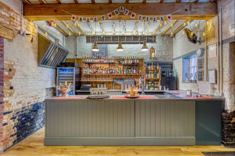 Rustic bar with drinks, lights and bunting