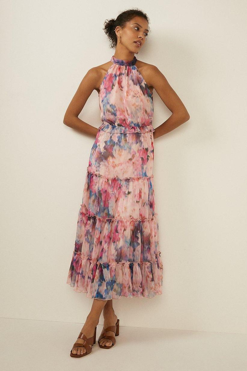 Girl wearing a floral halter neck midi dress