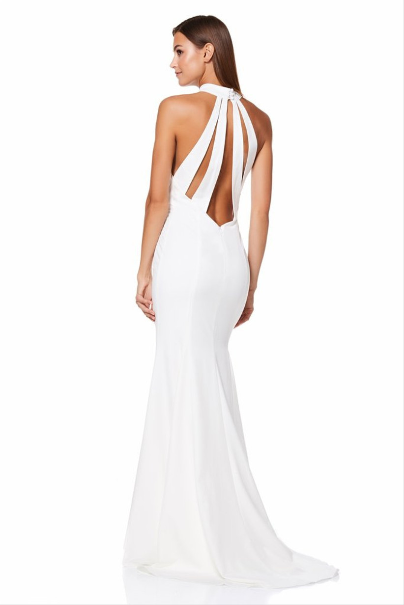 Girl wearing a white wedding dress with back cut outs
