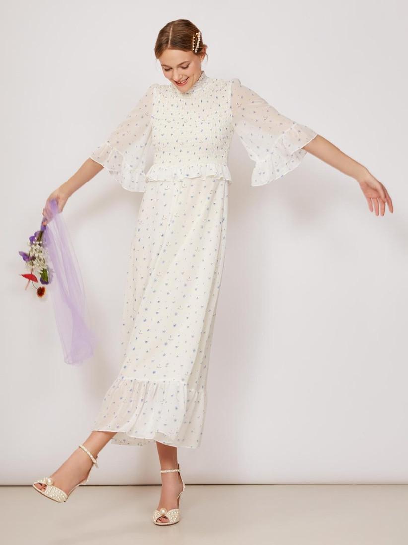 White and blue Kitri Studio wedding dress with three-quarter flutter sleeves