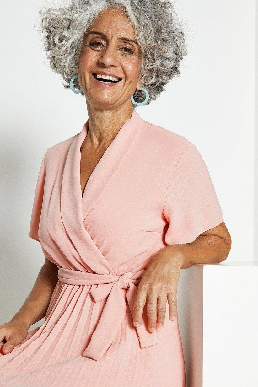 Woman wearing a pink wrap over dress